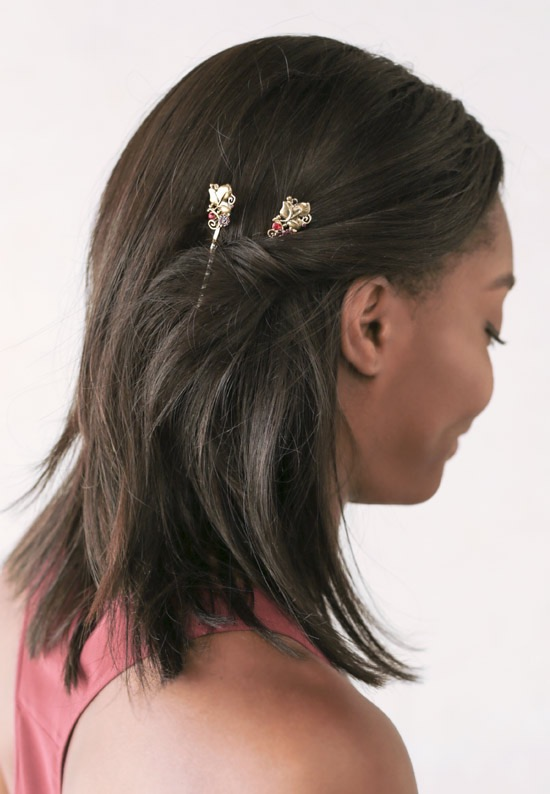 African-American lady wearing lilla rose bobby pins